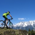 Mountain biker riding through the mountains