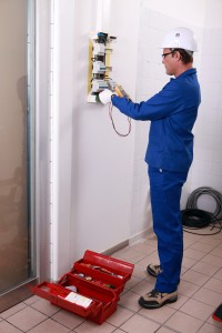Worker installing electricity